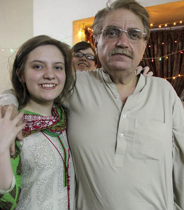 Idris Khattak disappeared in November. He is pictured with daughters Talia Khan and Shumaisa (in the background), on July 29, 2015, in Islamabad.