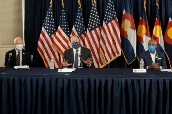 Gov. Jared Polis (center), flanked by Aurora mayor Mike Coffman (left) and Denver mayor Michael Hancock (right), announces a statewide mask mandate on July 16, 2020.