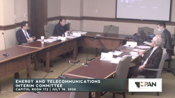 Republican members of Montana's Energy and Telecommunications Interim Committee conduct a meeting July 16, 2020 after Democratic members left prematurely in protest. The masked individual is a legislative staffer.