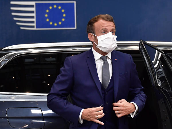 France's President Emmanuel Macron arrives Friday for a European Union meeting in Brussels, where leaders of the 27-member bloc will hold their first face-to-face summit since the pandemic to discuss a COVID-19 economic rescue plan.