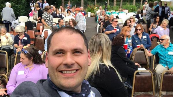 Gubernatorial candidate Anton Sakharov takes a selfie on July 9, 2020, at a forum held outside Camas.