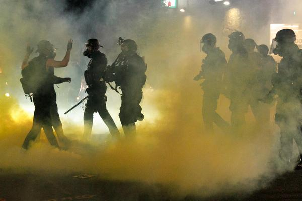Police confront demonstrators in Portland, Ore., on July Fourth.
