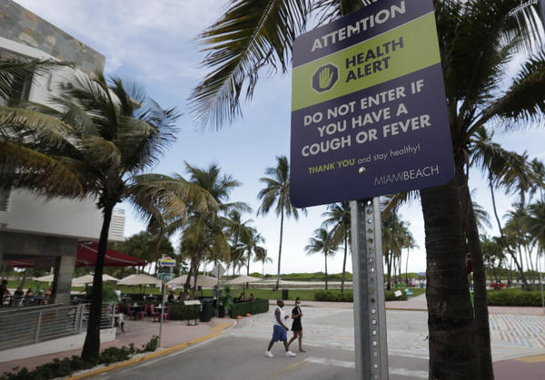 This Miami Beach sign is among the South Florida efforts to warn people about the coronavirus.