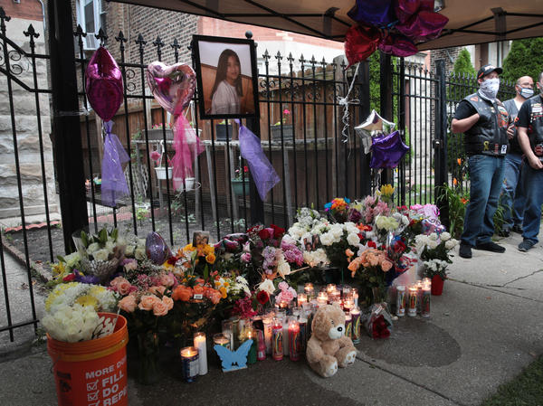 Candles burn in front of a memorial for Lena Nunez, 10, on June 29 in Chicago. The child was shot and killed by a stray bullet while watching TV with her brother in her grandmother's home, reports say.