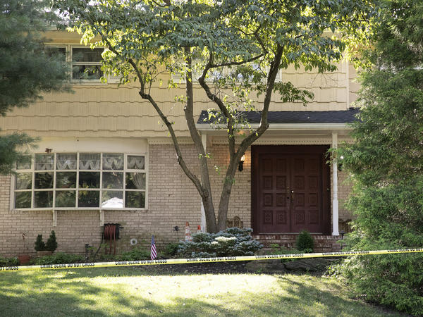 Crime scene tape surrounds the home of U.S. District Judge Esther Salas on Monday in North Brunswick, N.J. A gunman posing as a delivery person shot and killed Salas' 20-year-old son and wounded her husband on Sunday evening at their home before fleeing, according to officials.