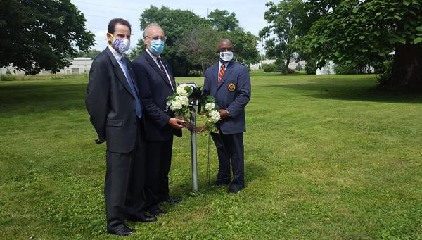 WIU Interim President Martin Abraham, Macomb Mayor Mike Inman, and Byron Oden-Shabazz, President of the McDonough County Branch of the NAACP (left to right) placed a wreath at the site of C.T. Vivian's boyhood home.