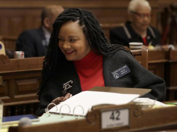 Georgia state Sen. Nikema Williams confers with a colleague on the floor of the Georgia Senate in February.