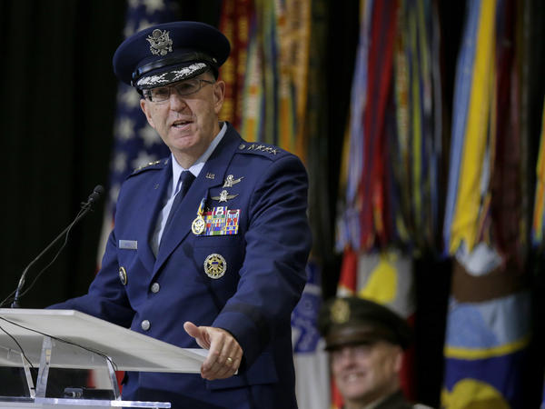 Air Force Gen. John Hyten speaks at Offutt Air Force Base in Nebraska during a change of command ceremony at U.S. Strategic Command in November. Joint Chiefs Chairman Gen. Mark Milley is behind, listening. Hyten is now vice chairman of the Joint Chiefs of Staff.