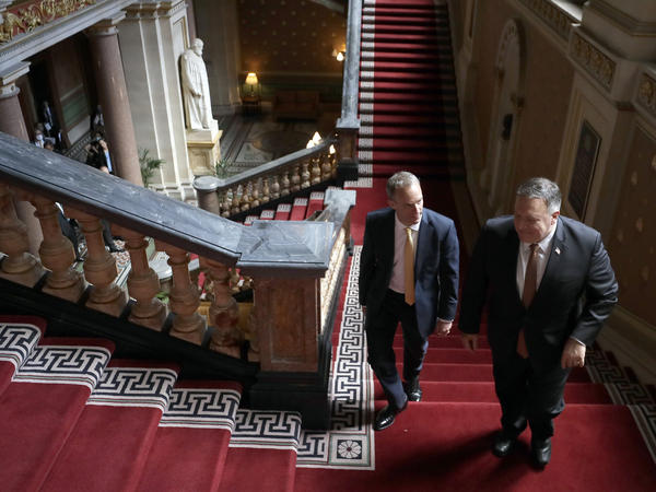 U.K. Foreign Secretary Dominic Raab, left, and U.S. Secretary of State Mike Pompeo walk up the stairs in the Foreign Office in London on Tuesday.