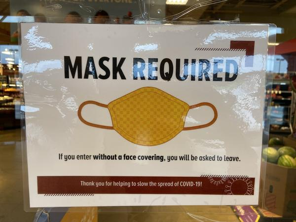 "A ""masks required"" sign on a store in central Ohio"