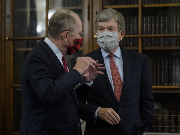 Sen. Lamar Alexander (left) speaks with Sen. Roy Blunt before the start of a Senate Rules Committee hearing Wednesday.