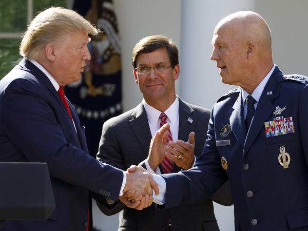 "Gen. John ""Jay"" Raymond, with President Trump and Defense Secretary Mark Esper during a ceremony to establish the U.S. Space Command last summer."