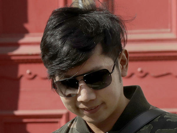 "Vorayuth ""Boss"" Yoovidhya, whose grandfather co-founded energy drink company Red Bull, walks to get in a car as he leaves a house in London, in April 2017. Charges have been dropped against the Thai heir to the Red Bull energy drink fortune who is accused in a 2012 car crash that killed a Bangkok police officer."