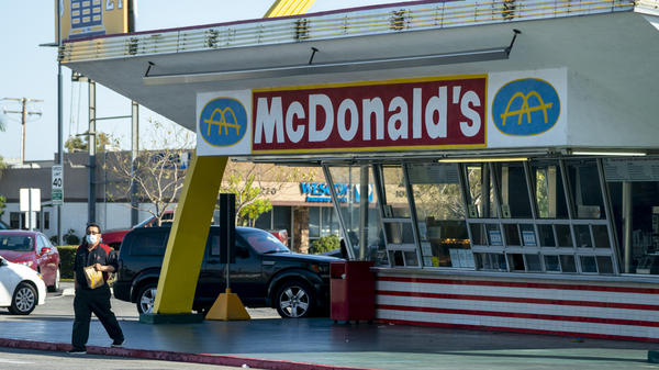 McDonald's will require all customers at its U.S. restaurants to wear a face mask, starting Aug. 1, the company says. Here, a customer wears a mask at the oldest operating McDonald's Corp. restaurant, in Downey, Calif., in April.