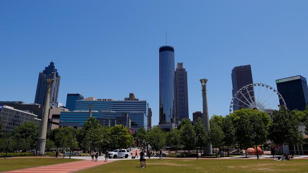 People visit Centennial Olympic Park in Atlanta on May 2. Many families in Atlanta and across the U.S. could face power disconnections as shut-off moratoriums imposed at the start of the pandemic expire. This comes as supplemental unemployment benefits are also set to lapse.