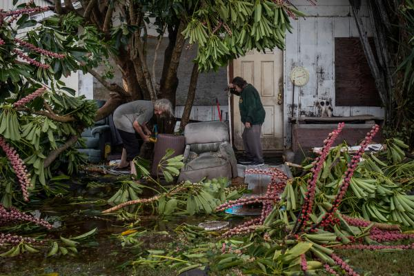 Charles Pecce, 70, and wife Sharon Pecce, 76, clear debris after returning to their destroyed home in the aftermath of Hurricane Hanna in Port Mansfield, Texas, U.S., July 26, 2020.
