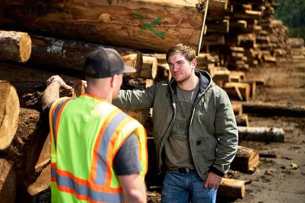 <p>Alek Skarlatos, right, speaks with a Douglas County woodworker during a campaign stop on Feb. 6, 2020.</p>