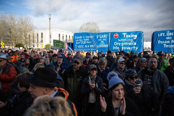 <p>The crowd claps at a Timber Unity rally at the Capitol in Salem, Ore., Thursday, Feb. 8, 2020.</p>