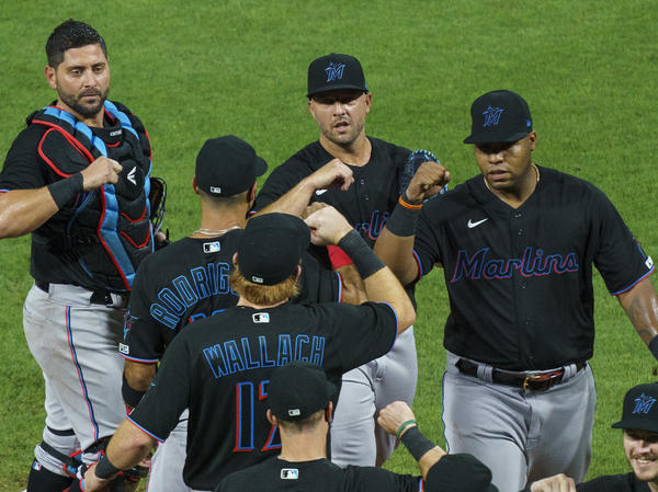 Members of the Miami Marlins celebrate a 5-2 win Friday against the Philadelphia Phillies. The Marlins' home opener Monday against the Baltimore Orioles has been postponed.