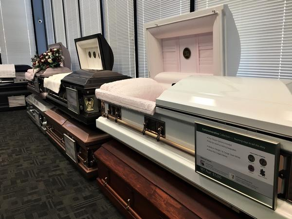 Caskets on display at Serenity Funeral Home in Kansas City, Mo., where many of the city's homicide victims are memorialized.