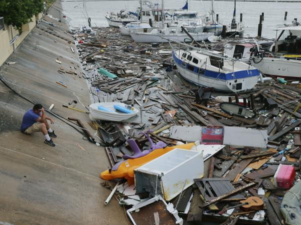 Allen Heath surveys the damage to a private marina in Corpus Christi after it was hit by Hanna, the hurricane that was later downgraded to a tropical storm, on Sunday. Heath's boat and about 30 others were lost or damaged.