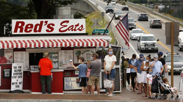 Customers wear masks on July 22 while waiting to order at Red's Eats, a popular lobster roll stand in Wiscasset, Maine.
