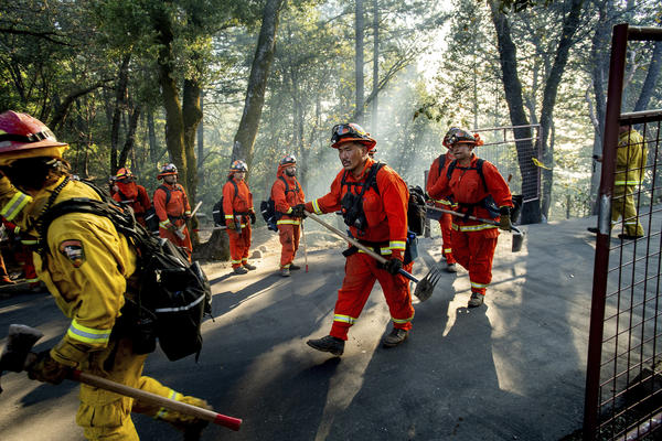 Inmate firefighters battle California's Kincade Fire on Oct. 29, 2019. In late June, officials locked down 12 inmate fire camps after outbreaks of the coronavirus within the state's prison system.