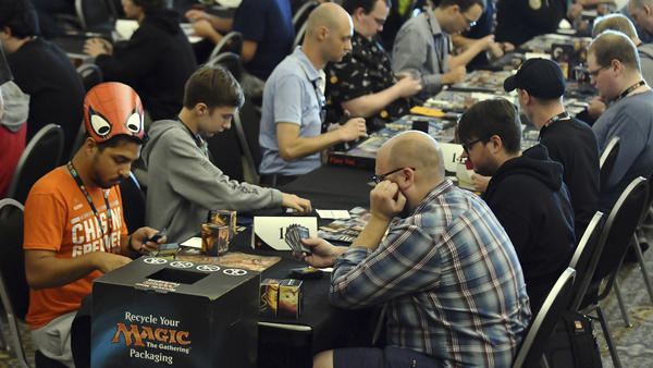 Players compete in a <em>Magic: The Gathering</em> tournament at Hasbro's HASCON in 2017.