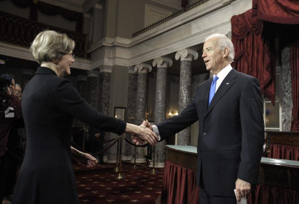 Joe Biden, then the vice president, welcomed Sen. Elizabeth Warren at her swearing-in ceremony in 2013. Seven years later, Biden could welcome Warren to his presidential campaign as a running mate. (Cliff Owen/AP)