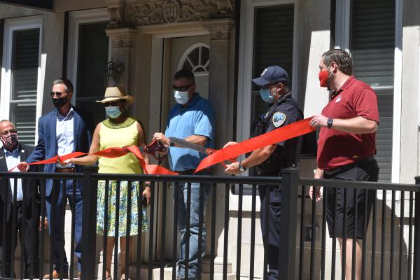 Officials cut the ribbon on the Police Resident Officer home in North Valley on Wednesday, July 29, 2020.