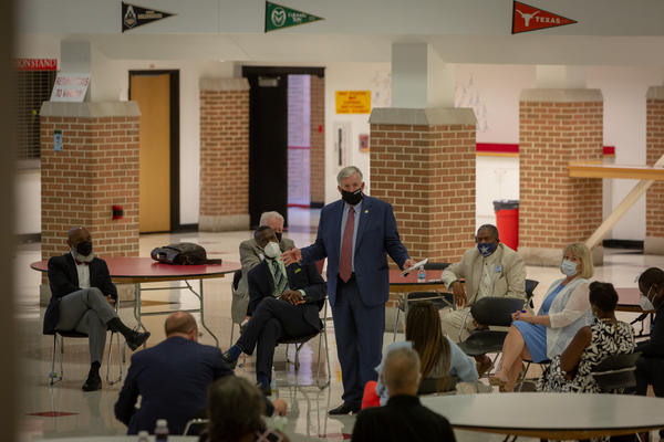 Missouri Gov. Mike Parson speaks to St. Louis-area school superintendents about back-to-school plans Wednesday at Jennings Senior High School.