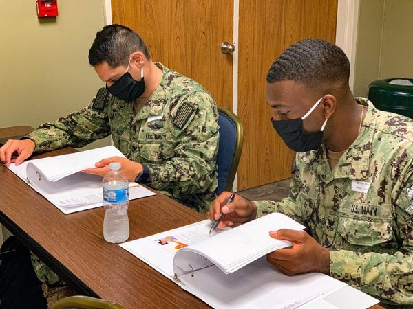 U.S. Navy Hospital Corpsman 2nd Class Ryon Kumrow (right) and Jose Naranjo (left), advanced radiology technologists from Naval Hospital Pensacola, review training material during orientation at Valley Baptist Medical Center- Harlingen.