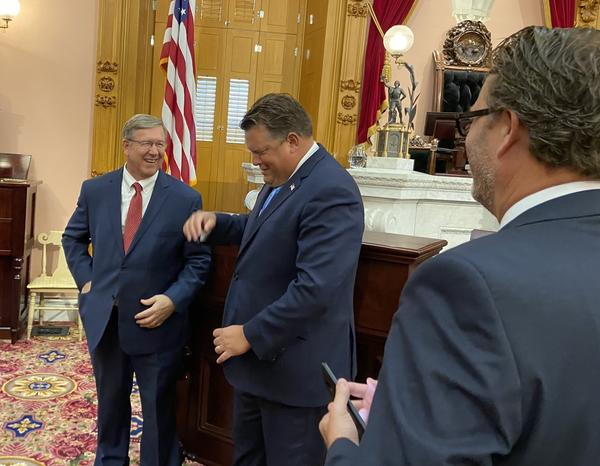 Speaker Bob Cupp (R-Lima, left) laughs with Rep. Jon Cross (R-Kenton) after session on July 30, as Rep. Todd Smith (R-Farmersville) looks on. Cross is among the Republicans who have proposed bills to push back on Gov. Mike DeWine's public health orders.