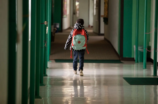 A student walks down the hallway at Cactus Elementary School in Cactus, Texas, in January