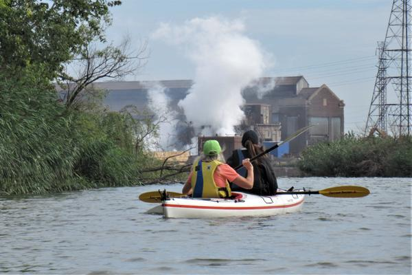 Sally Petrella and Marie McCormick kayak near one of the several industrial sites along the Rouge River.