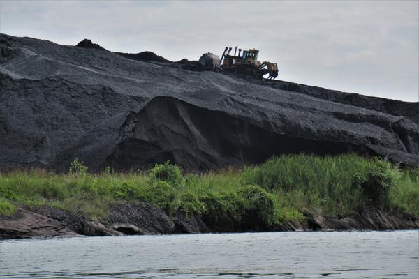 Mountains of coal along the Rouge River.