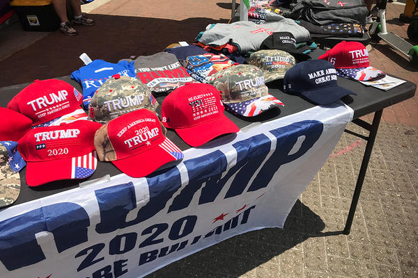 Trump merchandise lines a table in downtown Tulsa, Okla. on Saturday, June 20, 2020