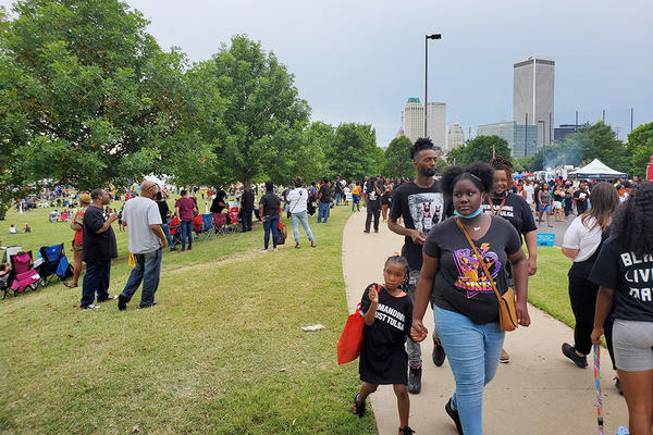 A large crowd celebrates the Juneteenth holiday in Tulsa, Okla. on Friday, June 19, 2020.