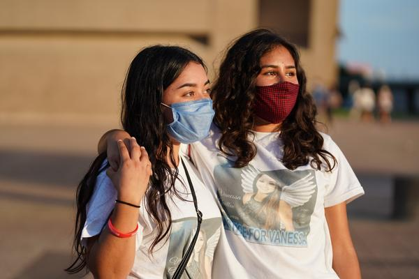Aileen Teniente and Emily Grimaldo, Vanessa Guillén's friends and teammates from high school, attend Tuesday's vigil.