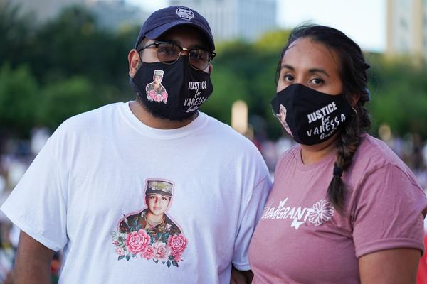 Ruth and Anthony Cobos, of Dallas, made their own masks for Tuesday's vigil.
