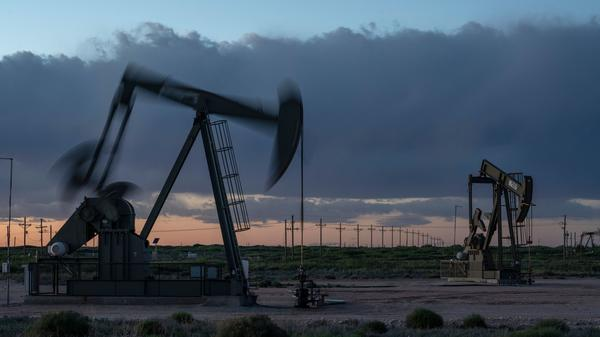Pump jacks operate at dusk near Loco Hills in Eddy County, New Mexico, on April 23. U.S. oil producers are grappling with prolonged low oil prices and the uncertainty created by the coronavirus pandemic.