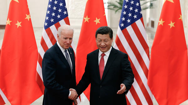 "Then-Vice President Joe Biden shakes hands with Chinese President Xi Jinping in Beijing on Dec. 4, 2013. ""I've traveled 17,000 miles with him,"" Biden told attendees at a campaign rally in Nevada earlier this year."