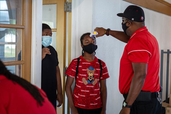 Students who attend the summer enrichment program in Jennings, Mo., have their temperature taken upon arrival.