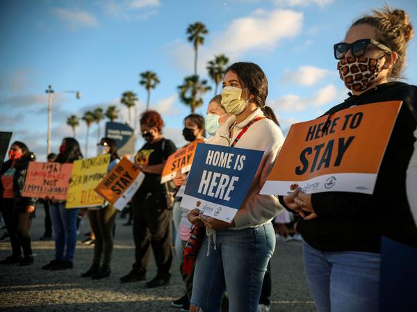 Protesters hold signs at a rally supporting the Supreme Court's ruling to uphold the DACA program on June 18. The Trump administration on Tuesday moved to continue its rollback of the program, despite court rulings.