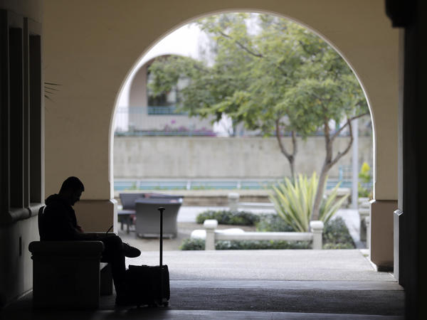 A man studies on the San Diego State University campus on March 12. San Diego State is a part of the California State University system and will be subject to the new general education requirement.