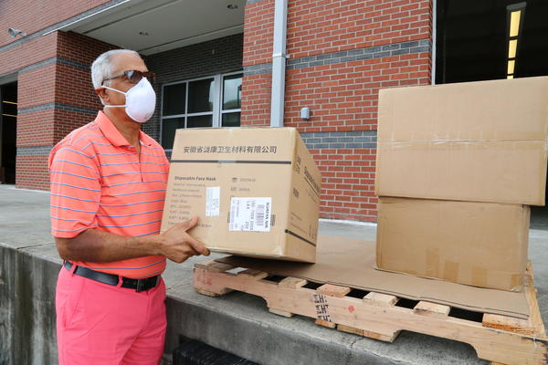 Orleans Parish School Board member Nolan Marshall, Jr. helps deliver personal protective gear to schools on July 24, 2020.