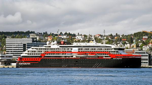 The expedition cruise ship MS Roald Amundsen is moored at a quay in Tromso, Norway, on Saturday. At least 36 crew members from the ship have tested positive for the coronavirus.