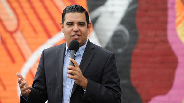 """Long Beach Mayor Robert Garcia, pictured in 2016, says his mother """"found"""" the American dream. She died of COVID-19 in July."""