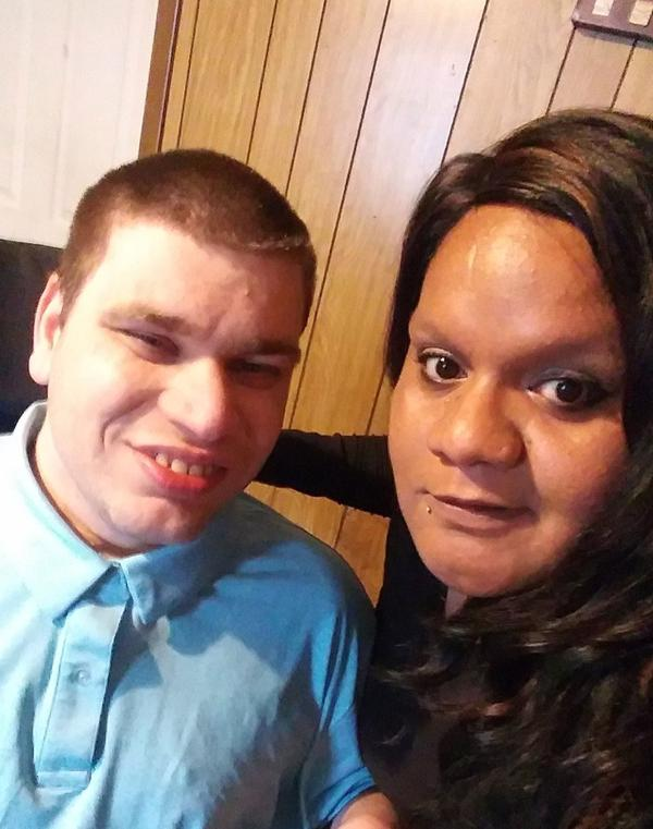 Kristina Ortiz, right, is Tim Himes' full-time caregiver. Himes was born with cerebral palsy.