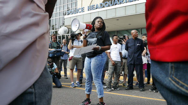 In this 2017 file photo, Cori Bush speaks on a bullhorn to protesters outside the St. Louis Police Department headquarters. Bush is projected to top longtime Rep. William Lacy Clay in Missouri's 1st Congressional District Democratic primary.